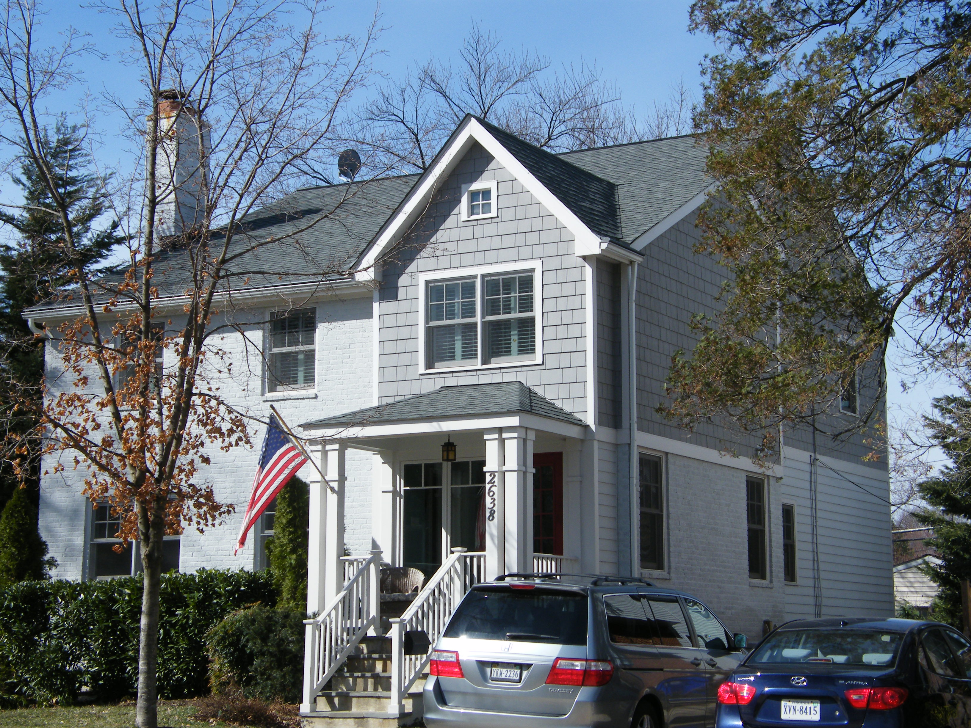 Two story addition to a classic arlington cape the cedar for Two story cape cod